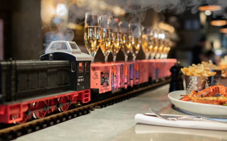 This Restaurant Is Serving Up Bottomless Champagne Delivered by Model Train